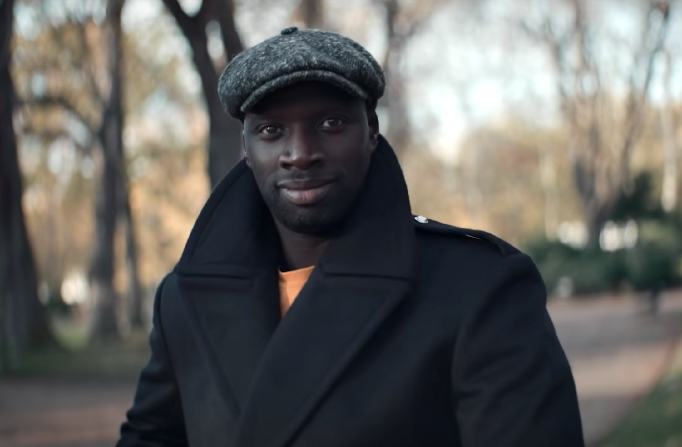 Screenshot from Lupin of Omar Sy wearing winter clothing