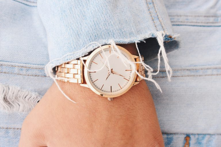 Hand wearing rose gold watch