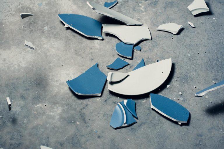 broke blue plate