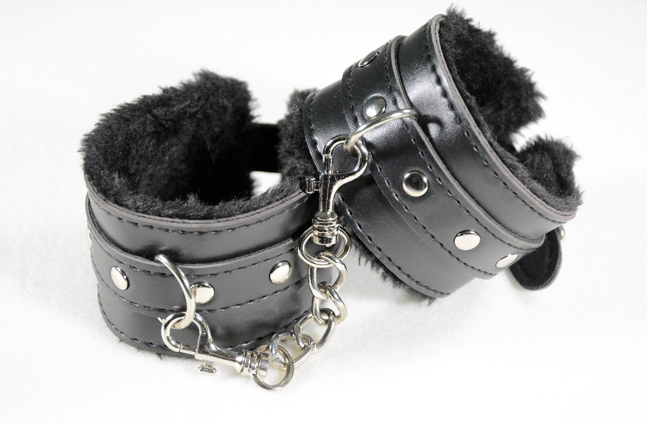 Furry black leather cuffs