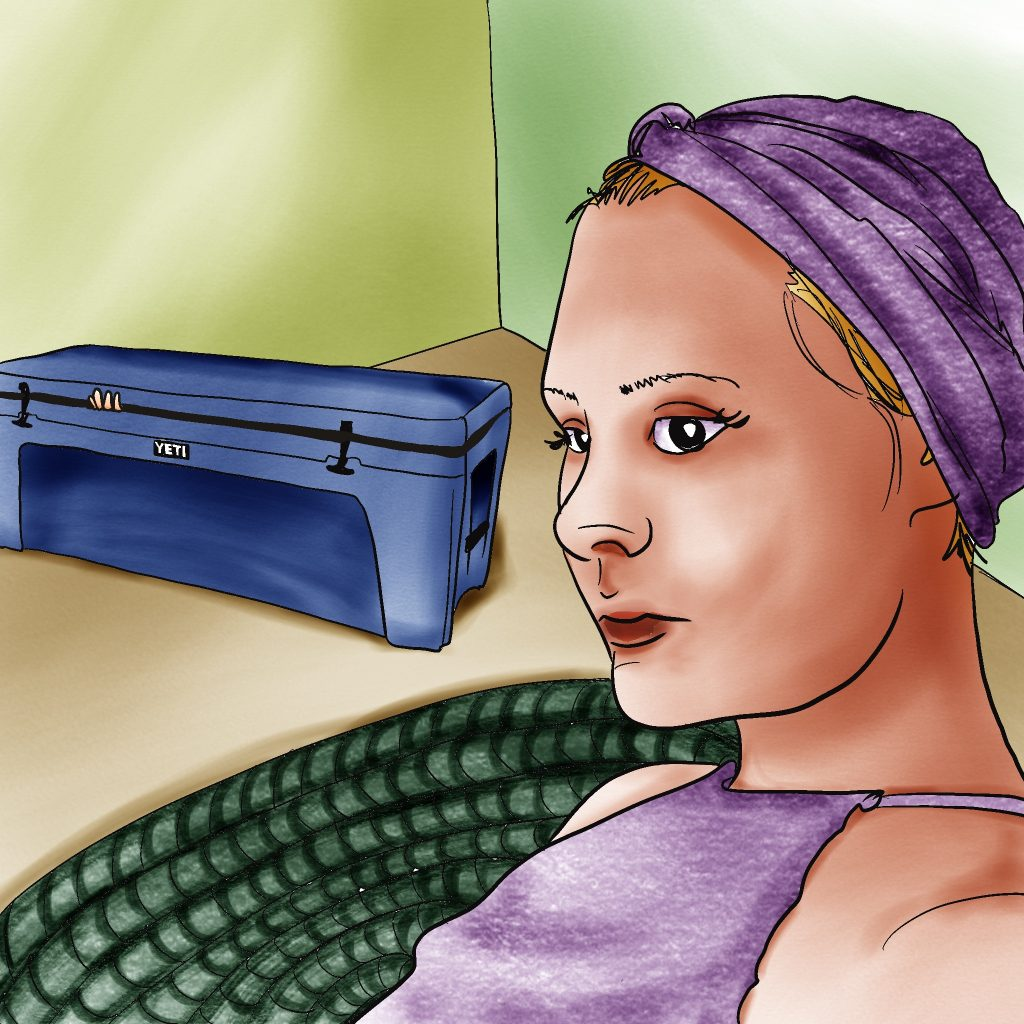 Woman with light skin and blonde hair mostly covered by a purple turban, sitting in front of a large blue Yeti-brand cooler with a few fingers peeking out.