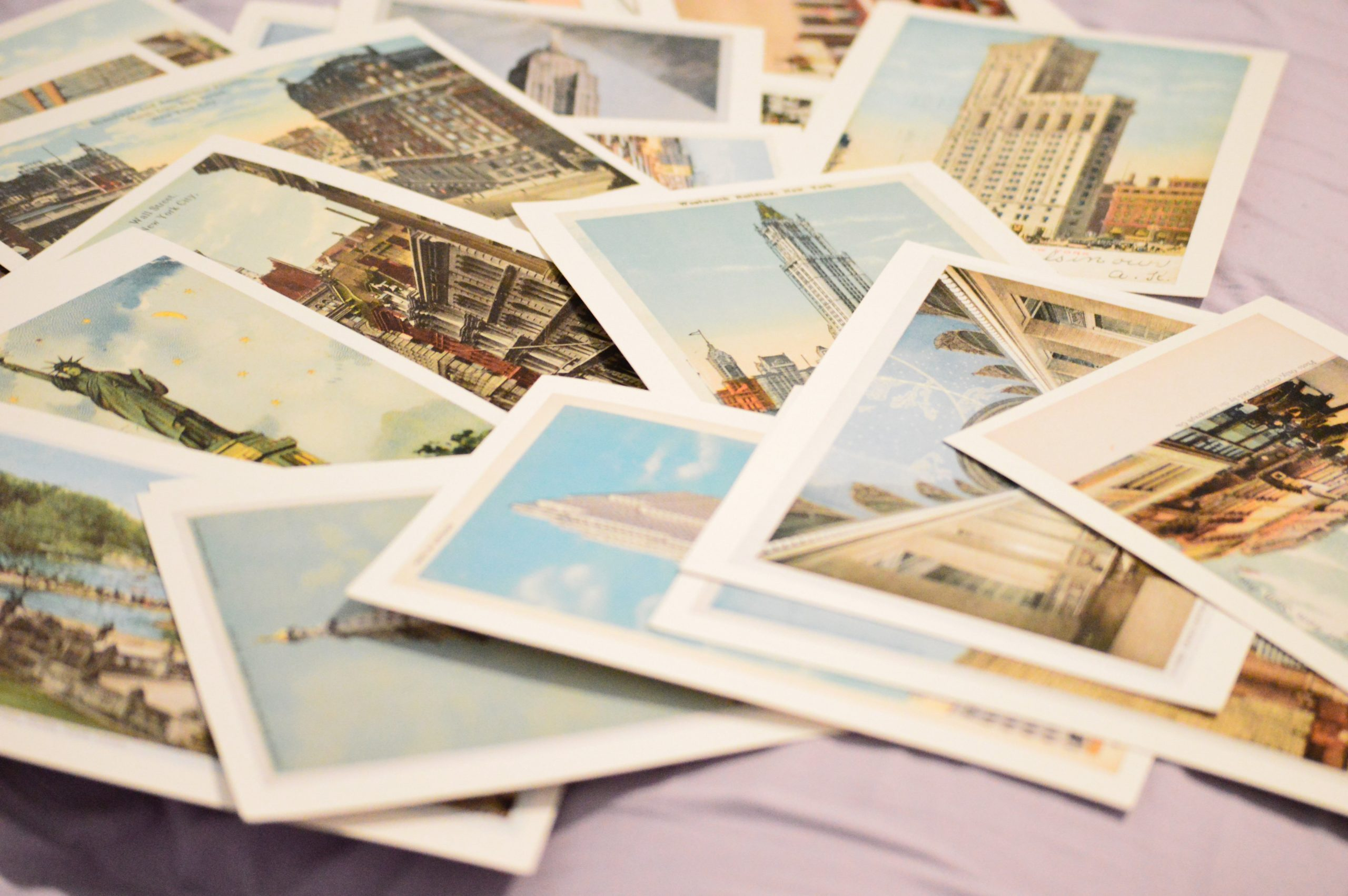 A pile of travel postcards