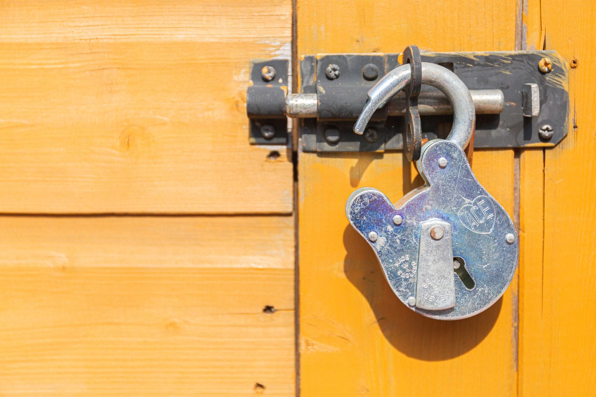 Unlocked padlock on yellow background