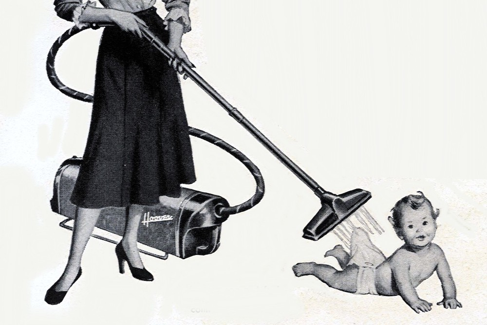 1950s-style advertisement showing a woman vacuuming a baby's diaper