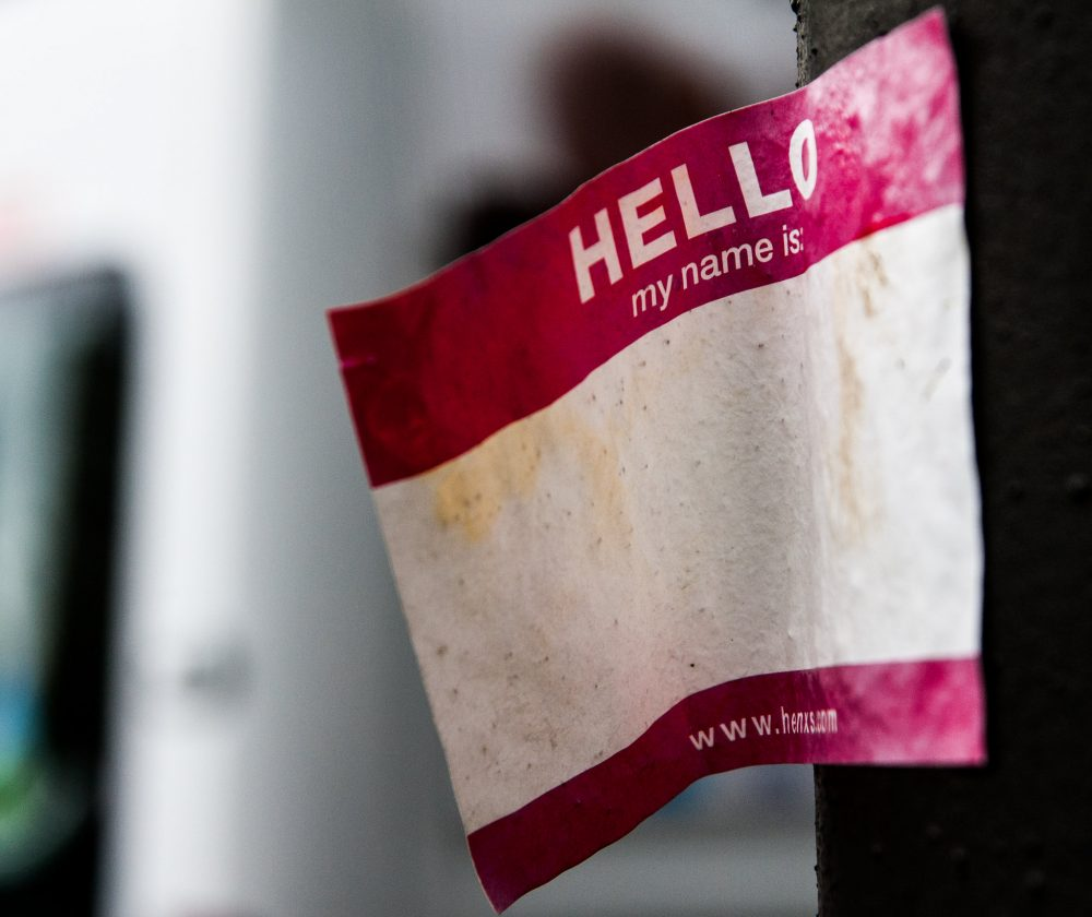 "Blank ""hello, my name is"" sticker stuck to pole"