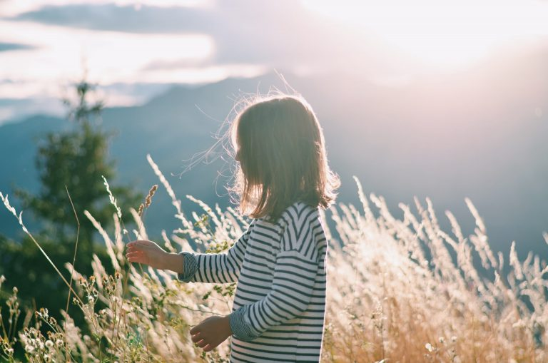 Young girl in brightly lit field
