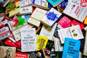 Pile of self-help books including The Daily Stoic by Ryan Holiday