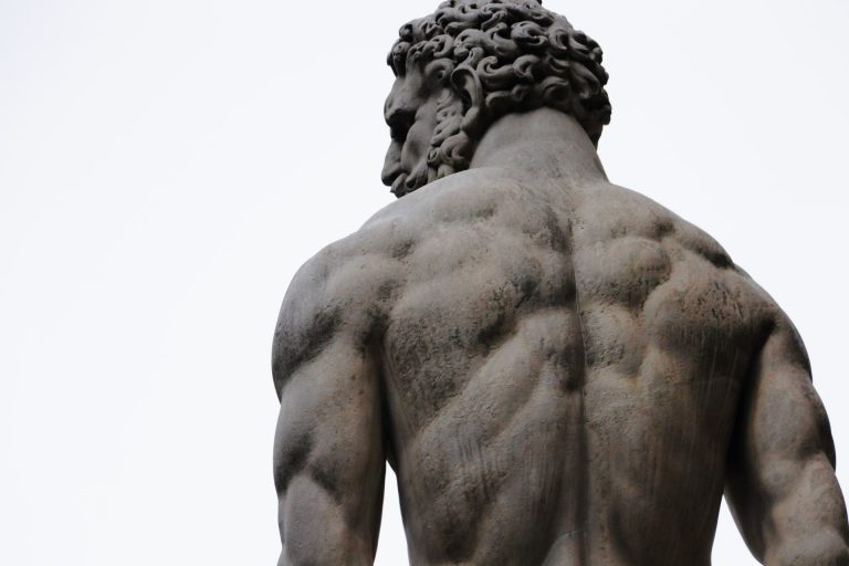 Statue of muscular man seen from behind
