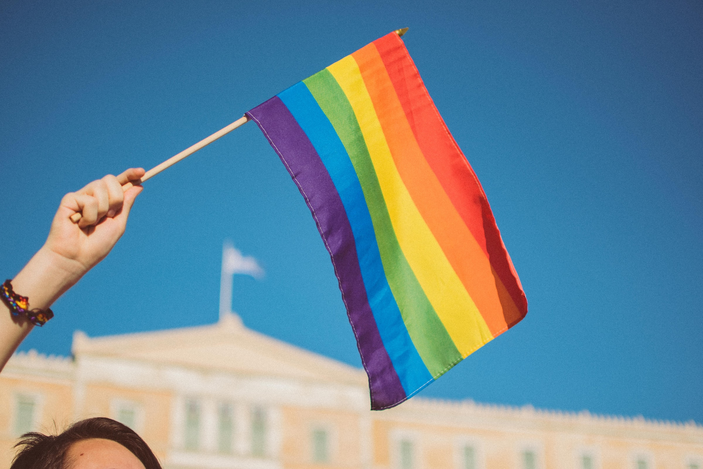 Woman holding pride flag