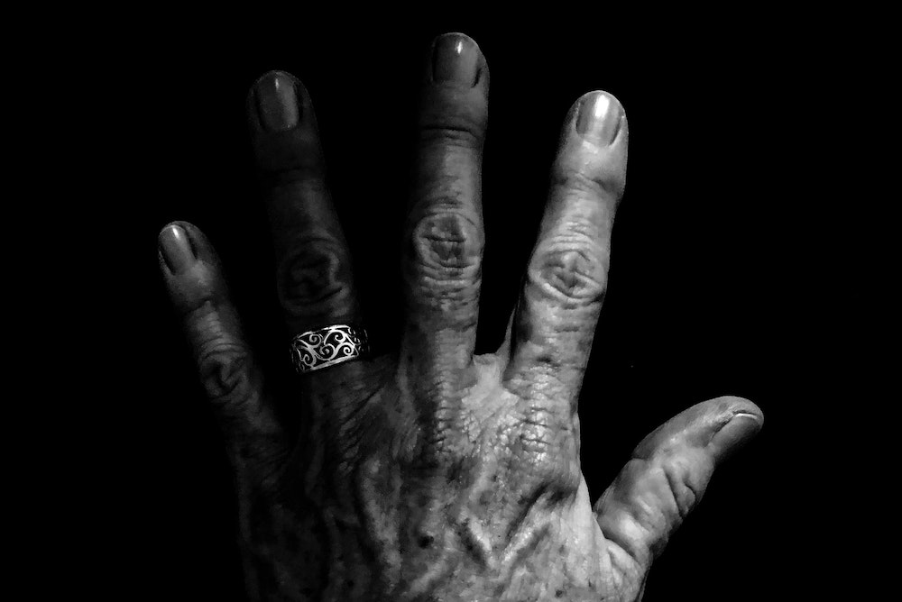 Old woman's hand in black and white