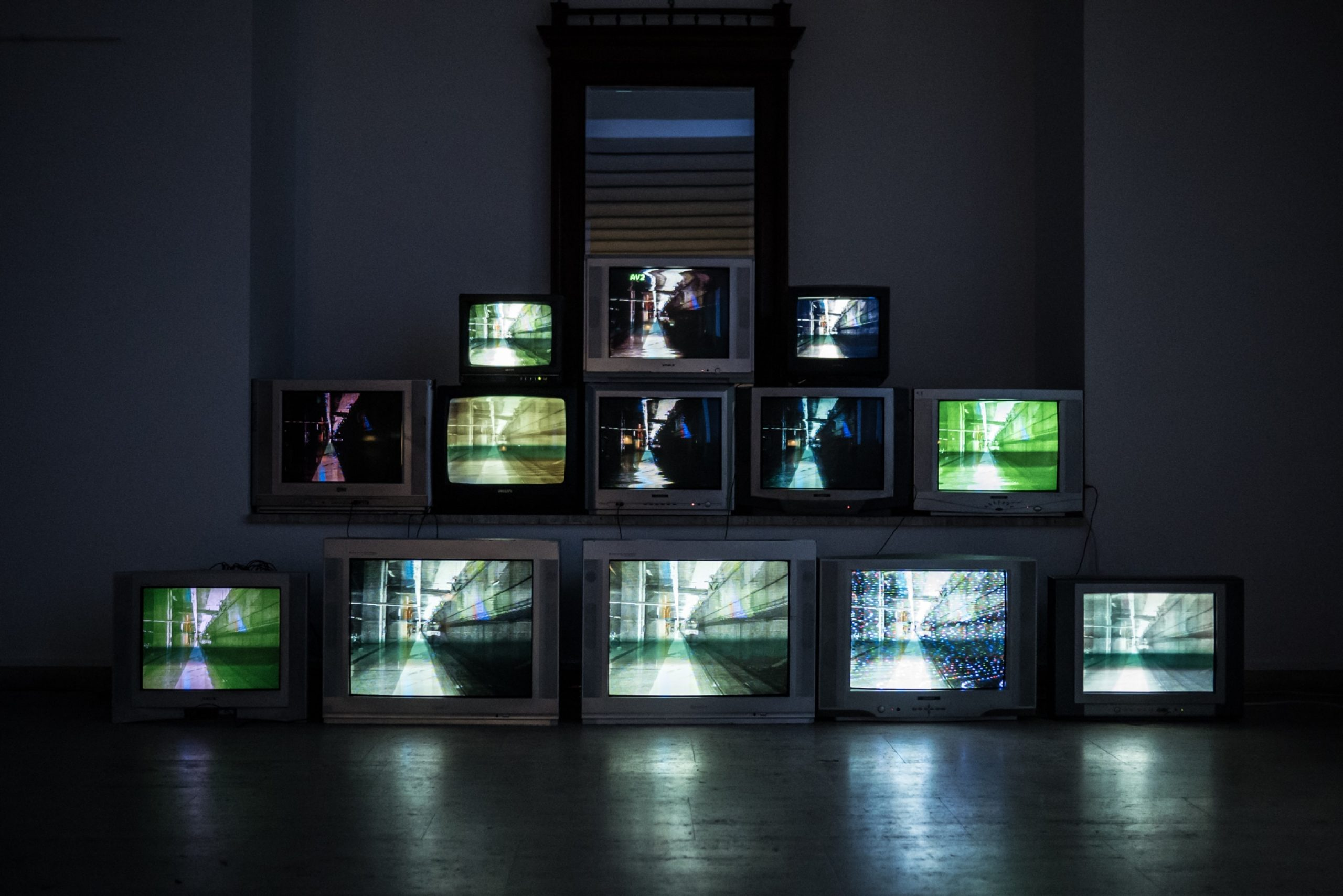 Pile of television with glitching screens