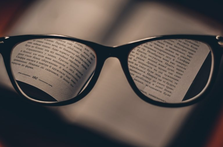 Pair of glasses over a book