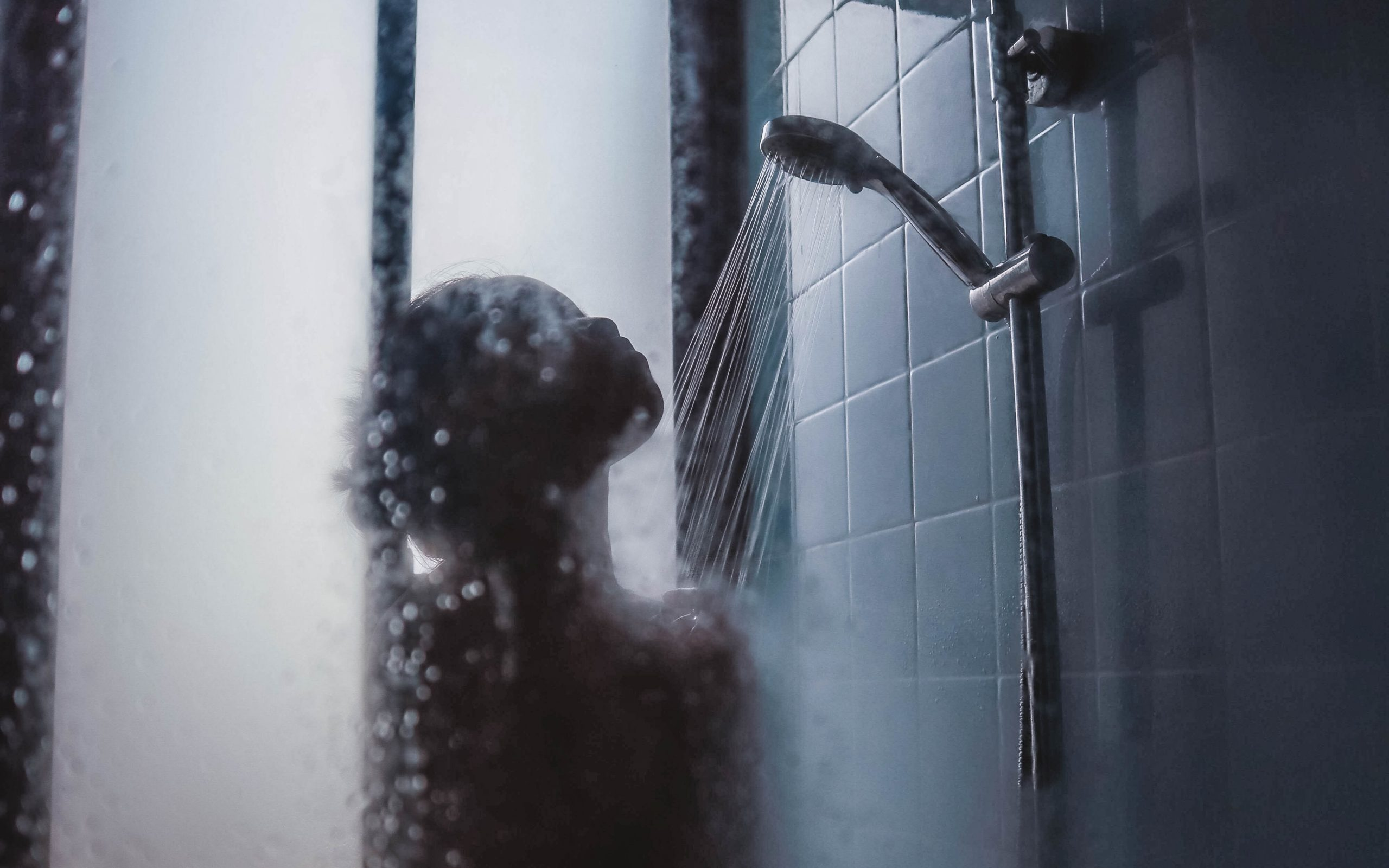 person in shower