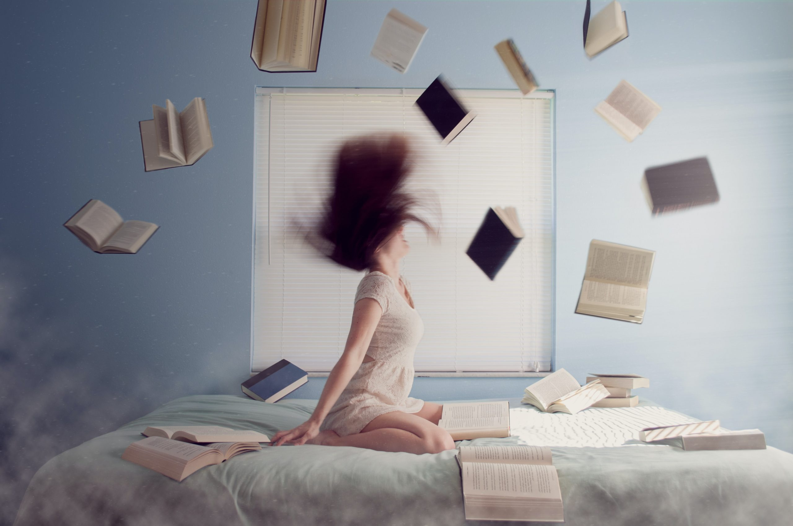 books flying around woman