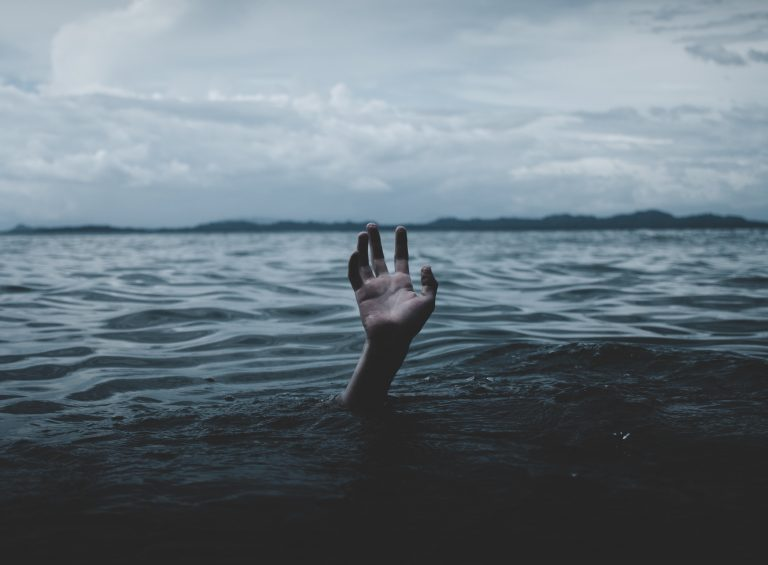 hand sticking up out of water