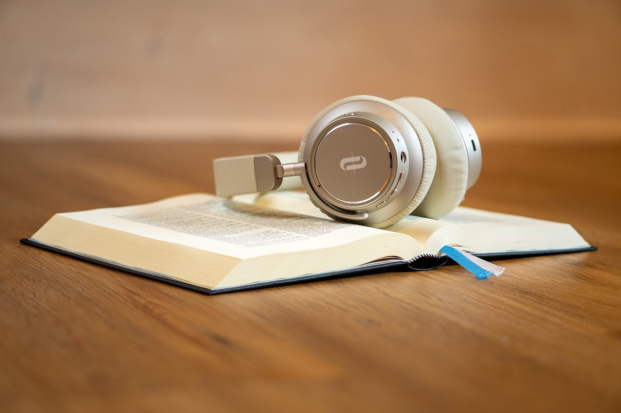 A pair of headphones resting on a book
