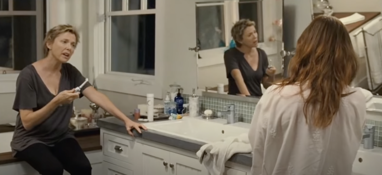 """Screenshot from """"The Kids Are Alight,"""" showing leads Nicole Allgood (played by Annette Bening) and Jules Allgood (played by Julianne Moore) talking in a bathroom"""